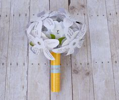 DIY Rehearsal Bouquet of Wishes. This replaces the ribbon and paper plate bouquets made at most bridal showers. Write your wish on a blank petal. Snap all the petals in place to create a beautiful wedding rehearsal bouquet. Then give the bride-to-be her bouquet of wishes.