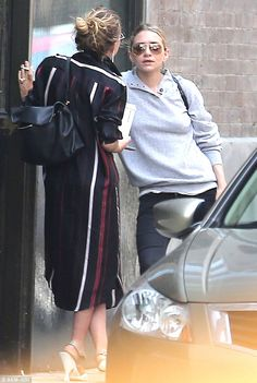 Smoke break: Ashley was seen on June 17 outside her SoHo apartment with twin sister Mary-K...