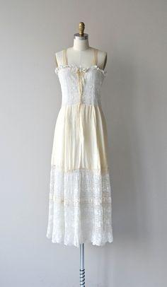 Vintage 1910s Edwardian camisole dress with white lace bodice, white ruffled trim, cream silk shoulder straps, cream silk ribbon tie, button-front