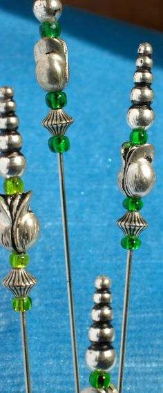 Silver Metal and Green Glass Hat Pin. $15.00, via Etsy.
