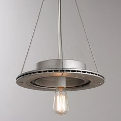 "Silver Rotor Pendant A fresh take on our reclaimed and repurpose automotive rotors pendants. We took our classic rustic rotors and added a silver finish for a more refined industrial look. These fixtures will surely add an unexpected ""green"" flair to your space, whether they are used alone or in multiples. A one-of-a-kind pendant, this piece will bring pizzazz to any space! 3 feet of chain. No two pendants a-like."