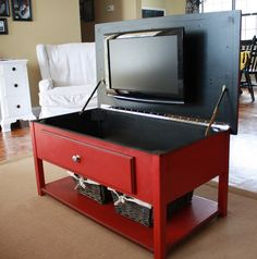 hidden tv storage - it's just Laine: The Amazing Red Coffee Table- I like this! He would think I threw the TV out! (& then trot off to a different room! Hidden Tv, Hidden Storage, Tv Storage, Storage Ideas, Hose Storage, Record Storage, Storage Solutions, Cabinet Storage, Pantry Storage