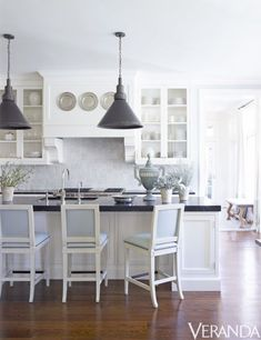 Nashville Home Designed Dy Suzanne Kasler Features Beautiful Black and White Kitchen Island #interiordecorstylesstools