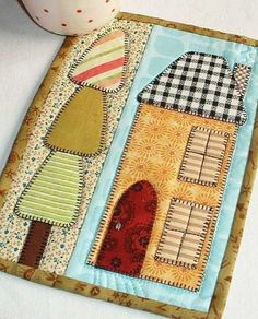 The House and Home mug rug from the Patchsmith's Special Days book.  This is one of two variations for this pattern.: