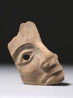 Right half of terracotta votive mask: warrior.