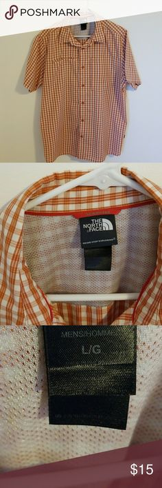 Men's NorthFace shirt Orange/white.  Right pocket Velcro closure,  left pocket zipper closure. NorthFace Shirts Casual Button Down Shirts