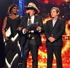 Marcia Hines & John Paul Young present Molly with his Aria Hall of a Fame award.