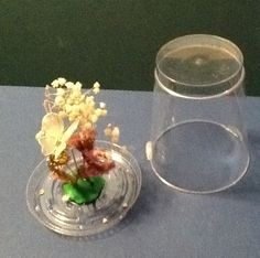 Have fun creating a flower design inside of a plastic glass.
