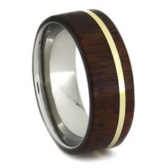 This attractive African Ipe band is pinstriped with a spectacular 14k yellow gold and features a smooth titanium sleeve. A beautiful natural wood