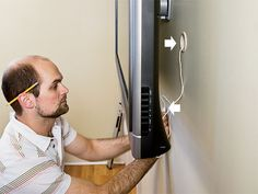 Your TV is slim, but your Home Theater gear is bulky. Heres how to hide the clutter.