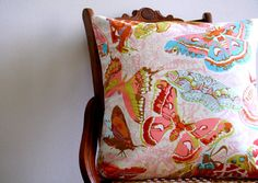 decorative throw pillow cover with bow ties / 18 x 18  / reversible / butterflies / rust peach pink teal gold yellow / cheetah print. $40.00, via Etsy.