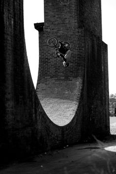 Karl Southern doing a flair at the infamous riverside full pipe. This spot is a accidental street BMX master piece.