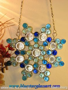 Blue Star Glass Art - could possibly use clear colored glass marbles or half round ones with large ones added as needed use clear silicone glue used for outdoor repairs of gutters