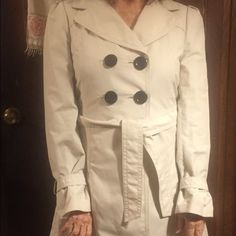 Ann Taylor all weather Coat Nice coat! Tan in color with 4 Black Buttons in the front and 2 in the back! Ann Taylor Jackets & Coats Pea Coats
