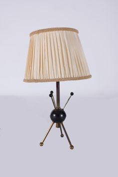 Boris LACROIX (1902-1984)  Spoutnik model  Pair of Retro Table Lamp,  constructed of metal and standing on a tripod base with spherical feet  4.25 x 3.75 x 9.25 in. - 10 x 9.5 x 23.5 cm.