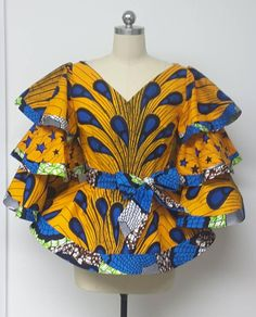 A beautiful and one-of-a-kind African Print Fine Tencel Denim Chiffon Asymmetrical Peplum with Zipper Detail Closure. A Transitional piece for all seasons exclusively designed and made by NanayahStudio. African Wear Dresses, Latest African Fashion Dresses, African Attire, African American Fashion, African Print Fashion, Africa Fashion, Trendy Ankara Styles, Kente Styles, African Blouses