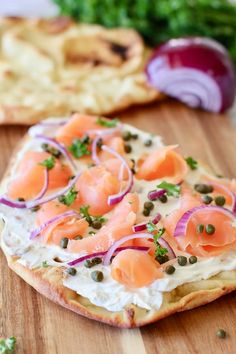 This Smoked Salmon Pizza makes an easy and elegant appetizer or light meal. Made with store bought pizza crust, flat bread or naan, topped with cream cheese, smoked salmon, onion and capers! Smoked Salmon Pizza, Smoked Salmon Recipes, Pizza Recipes, Seafood Recipes, Appetizer Recipes, Bread Recipes, Elegant Appetizers, Quick And Easy Appetizers, Pizza Naan