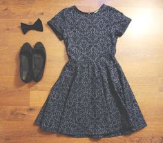 I love the dress, I would make the bow a color though cause I dont like wearing all black :p