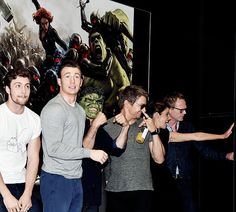 Aaron Taylor-Johnson (Quicksilver), Chris Evans (Captain America), Jeremy Renner (Hawkeye), Cobie Smulders (Maria Hill) and Paul Bettany (Vision) during the Marvel booth signing  at San Diego Comic Con, July 26, 2014.