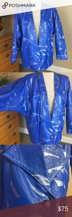 Vintage European Faux Leather Jacket This will be the funkiest jacket that you'll ever own. There's nothing subtle about it. It's beautiful blue color with silver brush stroke pattern all over. It features shoulder pads and a unique lapel design. This 80s vintage masterpiece is in excellent condition with no imperfections. Excellent quality, made in Switzerland. It's oversized size Medium, but will fit Large as well. [188] Vintage Jackets & Coats
