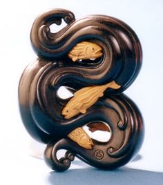 "Netsuke by Leigh Sloggett ""Fish at Play"", ebony and boxwood, 5.7cm, 2000"