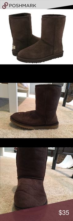 Short chocolate UGG boots Short chocolate brown UGG boots. Left boot has small scratch on the front (about 1/2 inch). Excellent used condition otherwise UGG Shoes Winter & Rain Boots