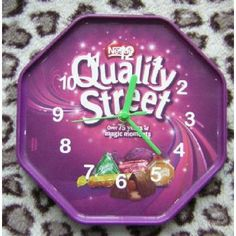 #QualityStreet #WallClock  For chocolate lovers everywhere and sweet toothers in general, we have converted the plastic lid of a tub of Quality Street sweets into a unique #wallclock. Measuring 220mm x 220mm, this battery operated clock features white numerals and green plastic handles. Now that's #quality ! #klicknc