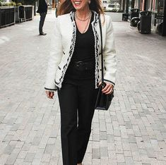 woman walking in black and white outfit