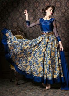 Be your distinct style diva with this navy blue fancy fabric and satin anarkali salwar kameez. The gorgeous digital print and patch border work through the attire is awe inspiring. Comes with matching...