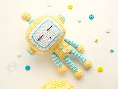 This cute sleepy robot will be a good toy for a baby, because it's bright, soft and safe.
