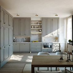 Swedish Kitchen with Gray Painted Cabinets & Marble Backsplash