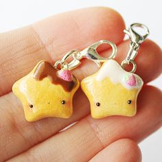 This Kawaii Cookie Star charm is the perfect accessory to add a touch of cuteness to your life! It is made out of strong oven bake polymer clay. The eyepin (finding) is secured with super glue to ensure durability. It was glazed with a high quality gloss varnish for protection and extra sh...