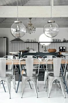 industrial. Love globe lights. Paint chairs bright red