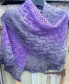 Free Knitting Pattern for One Skein Kindness Shawl - 3 sections of different lace patterns showcase ombre or multi-color yarn. Uses one skein of fingering yarn containing415 – 430 yards (379 – 393 m). Designed by Jaala Spiro for KnitCircus.Pictured projectby Knitaway1111