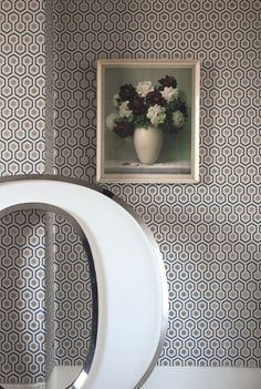An interesting small scale geometric wallpaper design made up of gold, cream and grey hexagons with metallic highlights.