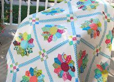 Dresden Plate Quilt. Tutorial is here: http://hyacinthquiltdesigns.blogspot.com/2011/02/dresdens.html
