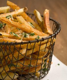These oven baked homemade French fries are shockingly crispy. Plus the healthy recipe gets a flavor boost from garlic, Parmesan, and fresh Parsley—you'll never want fast food fires again!