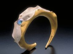 Alexandra Hart: OYSTER CUFF BRACELET  Sterling and 22k gold bimetal anti-clastic hammer formed and fabricated with bezel set New Zealand paua pearl and white diamond, commissioned in 2002, New York, NY