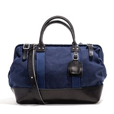 """This perfect carryall-meets-briefcase fits most laptops (up to 17"""") and, with its adjustable shoulder strap, signature leather luggage tag, and durable Denier o"""