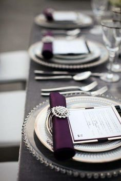 Wedding table settings with a pop of deep purple