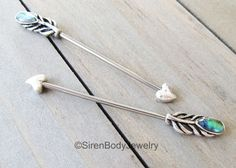 Gorgeous! Pin for later! $23.99 +S&H SirenBodyJewelryFeather industrial piercing barbell 14g abalone shell inlay heart arrow tip silver stainless steel straight bar ear piercing body jewelry by SirenBodyJewelry on Etsy