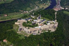 """Königstein Fortress (German: Festung Königstein), the """"Saxon Bastille"""", is a hilltop fortress near Dresden, in Saxon Switzerland, Germany. It is one of the largest hilltop fortifications in Europe and sits atop the table hill of the same name."""