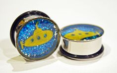 a pair of Beatles yellow submarine plugs made with blue candy sprinkles