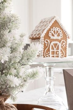 Modern meets Traditional Christmas Home Tour. This pretty white kitchen looks like a whimsical Christmas bakery. Check out the beautiful all white gingerbread house! White Gingerbread House, Gingerbread Christmas Decor, Christmas Tree Art, Christmas Greenery, Whimsical Christmas, Green Christmas, Felt Christmas, Christmas Home, Handmade Christmas