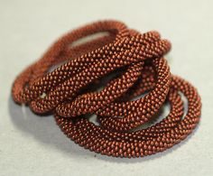 Copper Strand ... Bead crochet rope created from Czech glass seed beads in the color of an old penny.  Simply gorgeous.  $86