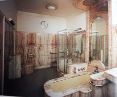 Pure Deco opulence in Doris Parkinson's wonderful peach-pink marble bathroom at Charters (The Art Deco House - Adrian Tinniswood). All that's needed is a fabulous glass full of #pinkfizz!