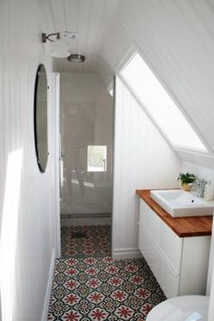 Adding an attic bathroom may seem like an appealing idea. One of the benefits of an attic bathroom is that it can create an additional living space in the house. House Bathroom, Home, Small Attic Bathroom, Upstairs Bathrooms, Shower Room, Tiny Bathroom, Bathroom Design, Bathroom Decor, Tile Bathroom