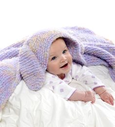 Free Knitting Pattern for Snuggle Bunny Blanket - Hooded blanket with bunny ears to keep baby warm all over. Knit in garter stitch, the bunny hood is shaped with short rows. Quick knit in bulky yarn. Designed by Premier Yarns.