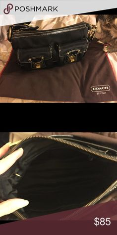 Small Black Coach Hanndbag Signature Black Coach handbag. This handbags has patent leather strap, two from pockets with gold turn locks, zipper pocket and the back and inside! This bag is in excellent condition! Has been sitting in a dust bag inside a Rubbermaid bin. I am a smoker and I do have two cats! Coach Bags Shoulder Bags
