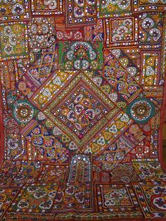 ethnic old textiles wall hanging made from old antique dresses patchwork from india tribes. $349.00, via Etsy.
